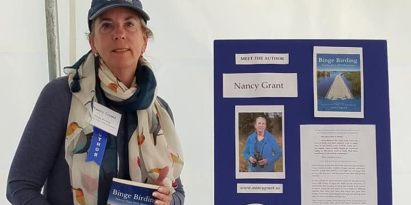 Author Nancy Grant signs book Binge Birding